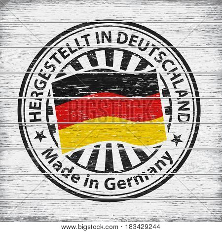 Vector stamp with flag of Germany, circular lettering Hergestellt in Deutschland on wooden background