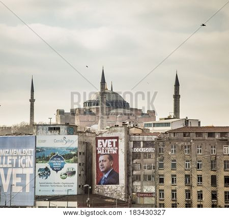 ISTANBUL, TURKEY-APRIL 1, 2017: A political poster for President Recep Tayyip Erdogan decorates a wall in front of the Hagia Sophia.