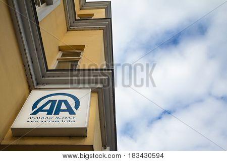 SARAJEVO BOSNIA HERZEGOVINA - APRIL 17 2017: Logo of Anadolu Agency on their Bosnian main office in Sarajevo.