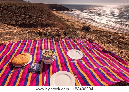 Dinner with couscous with view upon Legzira beach, Sidi Ifni, Souss-Massa-Draa, Morocco.