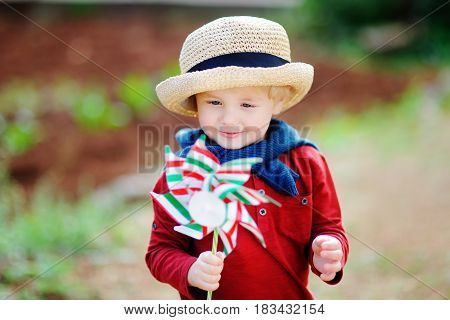 Happy Toddler Boy Holding Italian Flag Outdoors