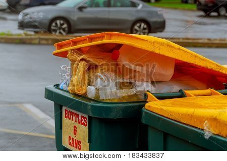 Overflowing garbage bins with household waste in the city Dumpsters being full with garbage