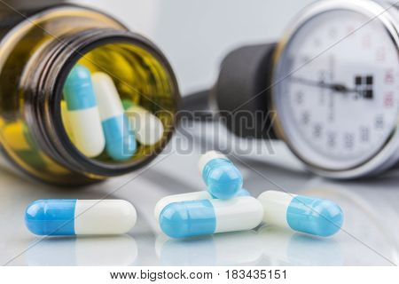 Blue and white pills container transparent on white bacground