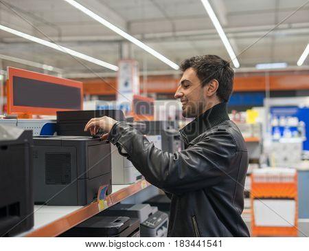 customer choosing MFP Printer in supermarket shop