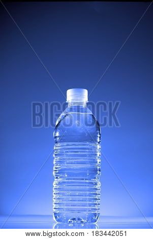 Water bottle holding a cool refreshing drink
