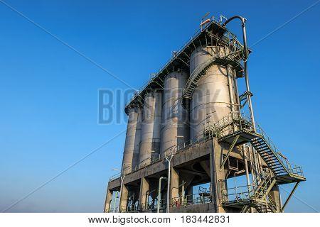 Silo storage for plastic resins Storage silo on blue sky background.