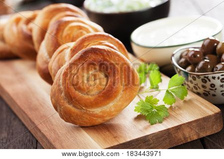 Phyllo pastry cheese pies served with yogurt and olives
