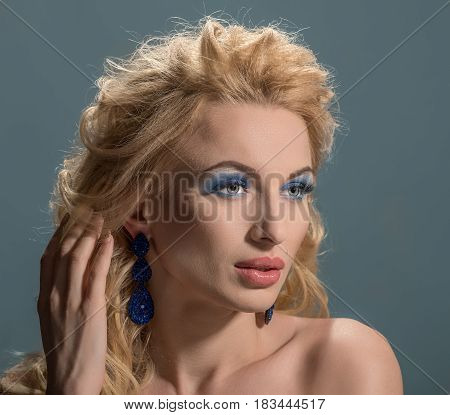 Portrait of attractive young blonde woman with evening make-up