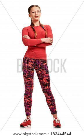 Full portrait of fit slim woman in sportswear with crossed hands