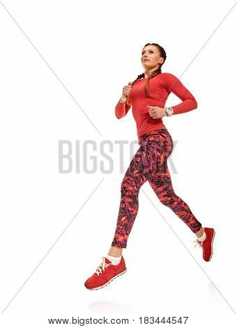 Young fit healthy sportswoman jogging on white background