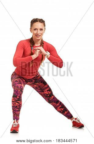 Young sportswoman stretching and warming-up before hard training