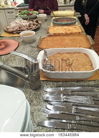 Various Dishes And Casseroles At A Thanksgiving Pot Luck