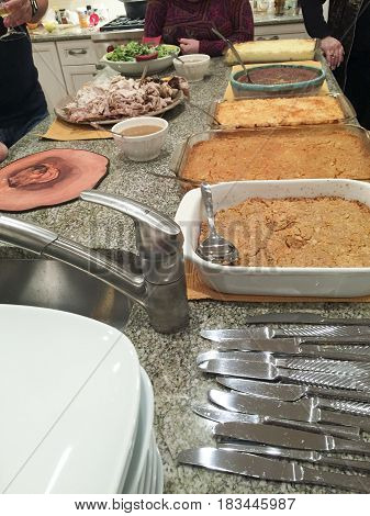 Various dishes and casseroles at a Thanksgiving pot luck (potluck) dinner