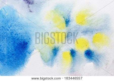 Abstract background of yellow blue watercolor paint. Drawing on wet paper. Spreading of watercolor paint on paper. Element of design. Tutorial.