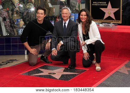 LOS ANGELES - APR 17:  Daniel Henney, Gary Sinise, Alana De La Garza at the Gary Sinise Honored With Star On The Hollywood Walk Of Fame on April 17, 2017 in Los Angeles, CA