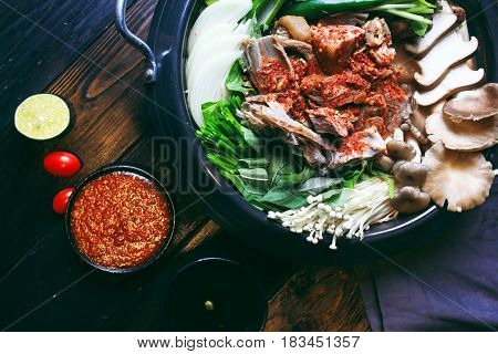 Prepared Hot Pot Of Goat Meat With Mushroom, Vegetables And Chili Sauce