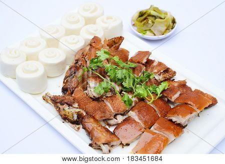 Chopped Grilled Baby Pig In Chinese Style With Dumplings On White Platter