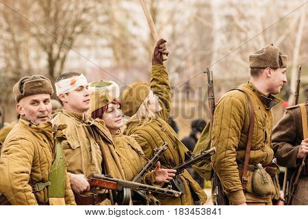 Gomel, Belarus - November 26, 2016: Soviet soldiers of the red army stand in line after the battle to assimilate the city of Gomel. Reconstruction