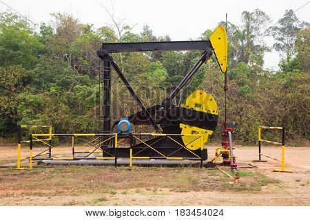 Pumpjack in an oil well in Tanjung, Kalimantan, Indonesia