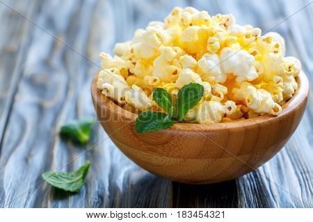 Crispy Popcorn With Salt In A Wooden Bowl Closeup.