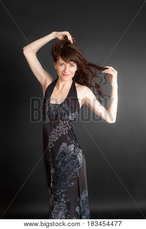 Slender woman in a dress on a black background