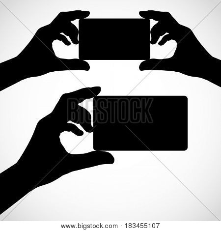 Two hands with fingers spread out and card.  Silhouettes element for your design.
