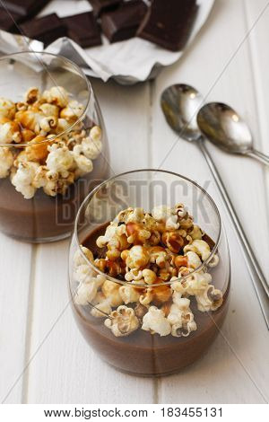 Hot Chocolate In Glass With Pop Corn On Table