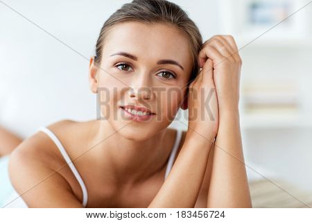 beauty and people concept - close up of beautiful happy young woman at home