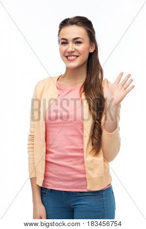 gesture, fashion, portrait and people concept - happy smiling young woman in cardigan waving hand over white
