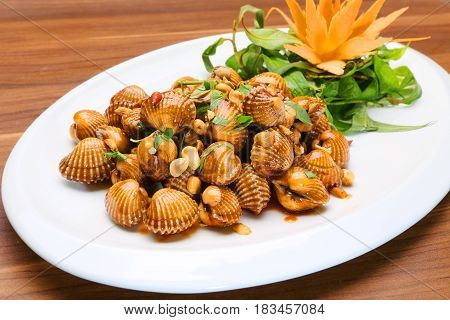 Sauteed Blood Cockles With Peanuts And Laksa Leaves On White Platter