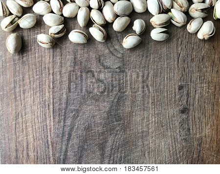Background with ripe pistachios with place for your text