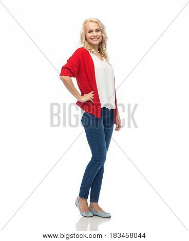 fashion, portrait and people concept - happy smiling young woman in red cardigan and jeans