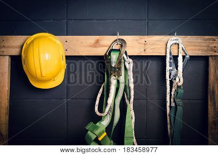 Standard construction safety helmet fall protection on black background