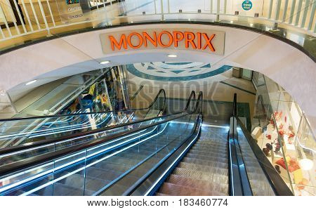 PARIS - MARCH 13, 2017: Escalator leading to Monoprix grocery store in Passy Plaza commercial centre in Paris. Monoprix is one of the major retail chains in France.
