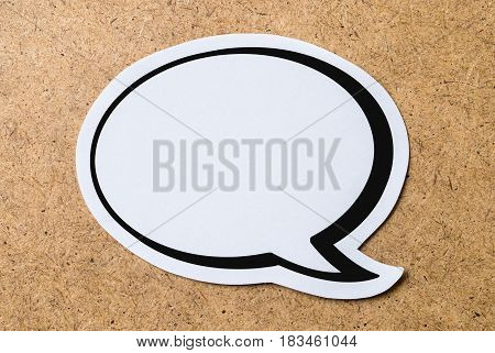 Large blank speech bubble on a light brown wooden cork board background. Chat bubble cut from paper and cardboard. Message, chat and communication concept with a lot of free empty copy space for text.