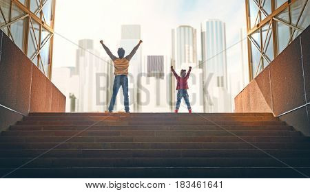 Father and child climb upstairs. Family rejoices on the background of skyscrapers of the city.