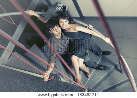 Happy young man and woman flirting at apartment