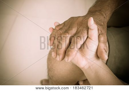 Hands of elderly man holding touches asian kids World Kindness Day concept and Adult day care soft tone