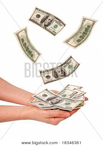 Female hands and falling money