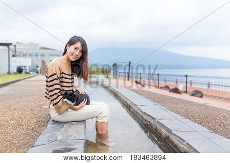 Woman enjoy her foot onsen at outdoor