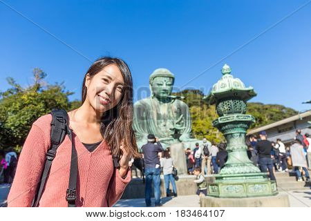 Woman travel in Giant Buddha of Japan