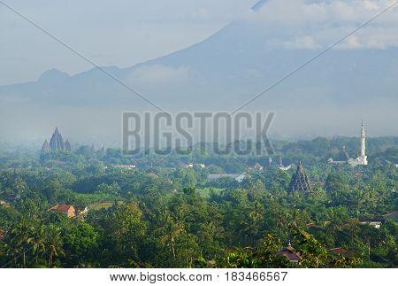 Prambanan Temple, Sojiwan Temple, and Merapi Mountain in one frame