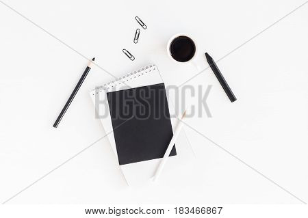 Workspace with notebook cup of coffee paper blank pencils. Business concept. Flat lay top view