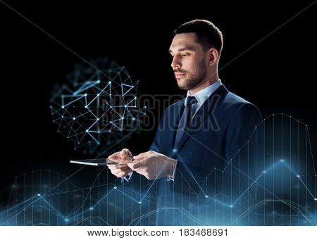 business, people and modern technology concept - businessman in suit working with transparent tablet pc computer over black background and low poly projection