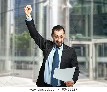 Very happy businessman reading a contract