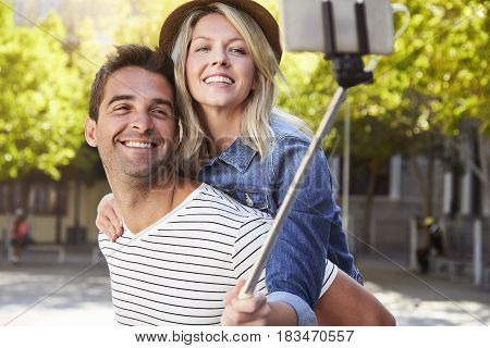 Young Handsome couple posing for selfie smiling