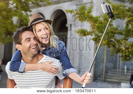 Young Happy selfie couple in city smiling