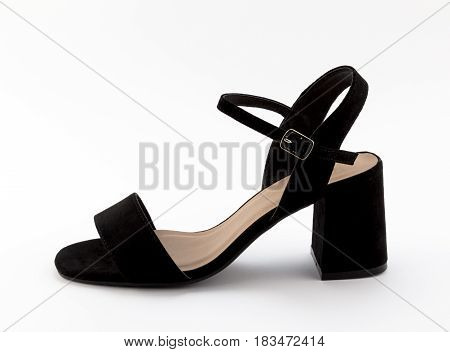 Studio photo of an elegant block heeled black velvet lady sandal