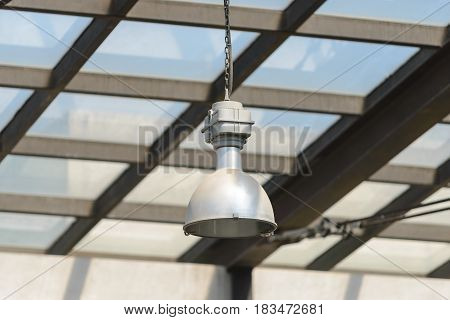Close-up To Lamp Under The Glasshouse Lights