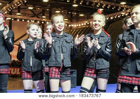 St. Petersburg Russia - 15 April, Teenagers clap their hands,15 April, 2017. International Motor Show IMIS-2017 in Expoforurum. Dance show group of teenagers in the style of hip-hop.